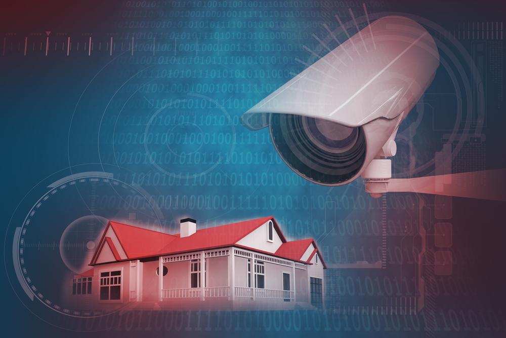 CCTV camera against shiny blue binary code on black background